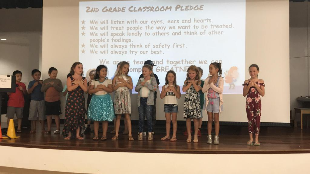 Grade 2 students sing pledge song.