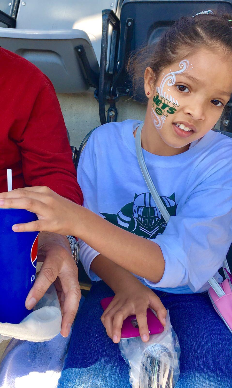 L. Ramirez showing off her Jets pride with her face painted