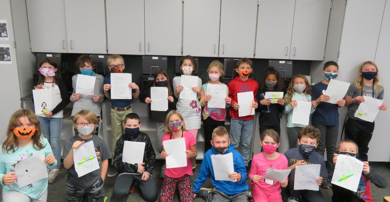 Lee students write letters to their pen pals in Texas.