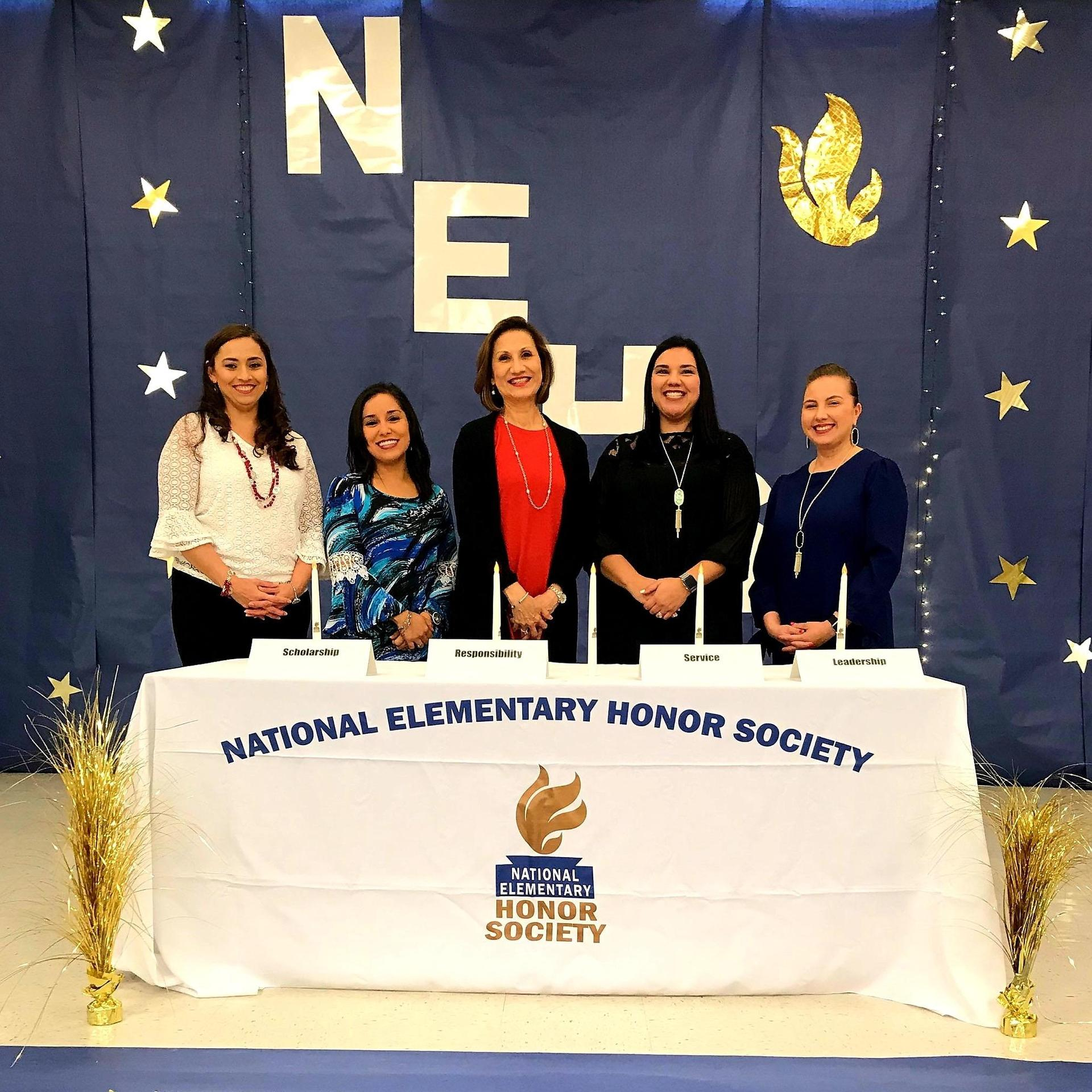 NEHS staff posing at ceremony