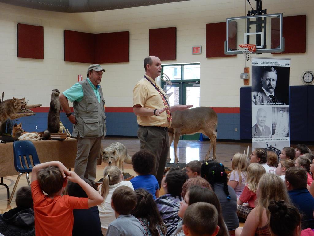 Mr. Foulke introduces Ward Burton Wildlife Representative  to students