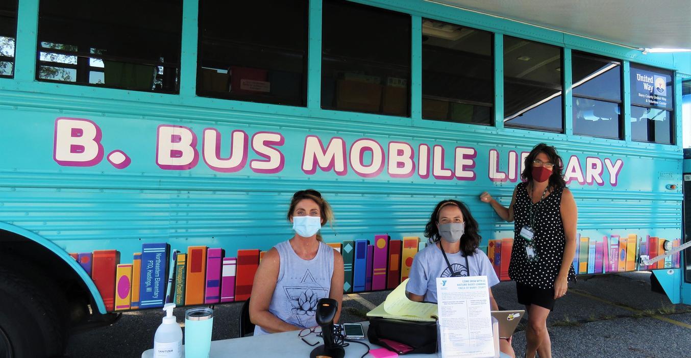 TK Virtual School teachers man the B. Bus mobile library.