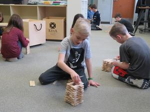 Zac Dykhouse uses his Keva Planks to build a tower. His goal is to make it as high as possible using all the planks.
