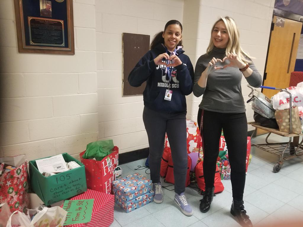 ms velazquez and 8th grade student giving the heart sign