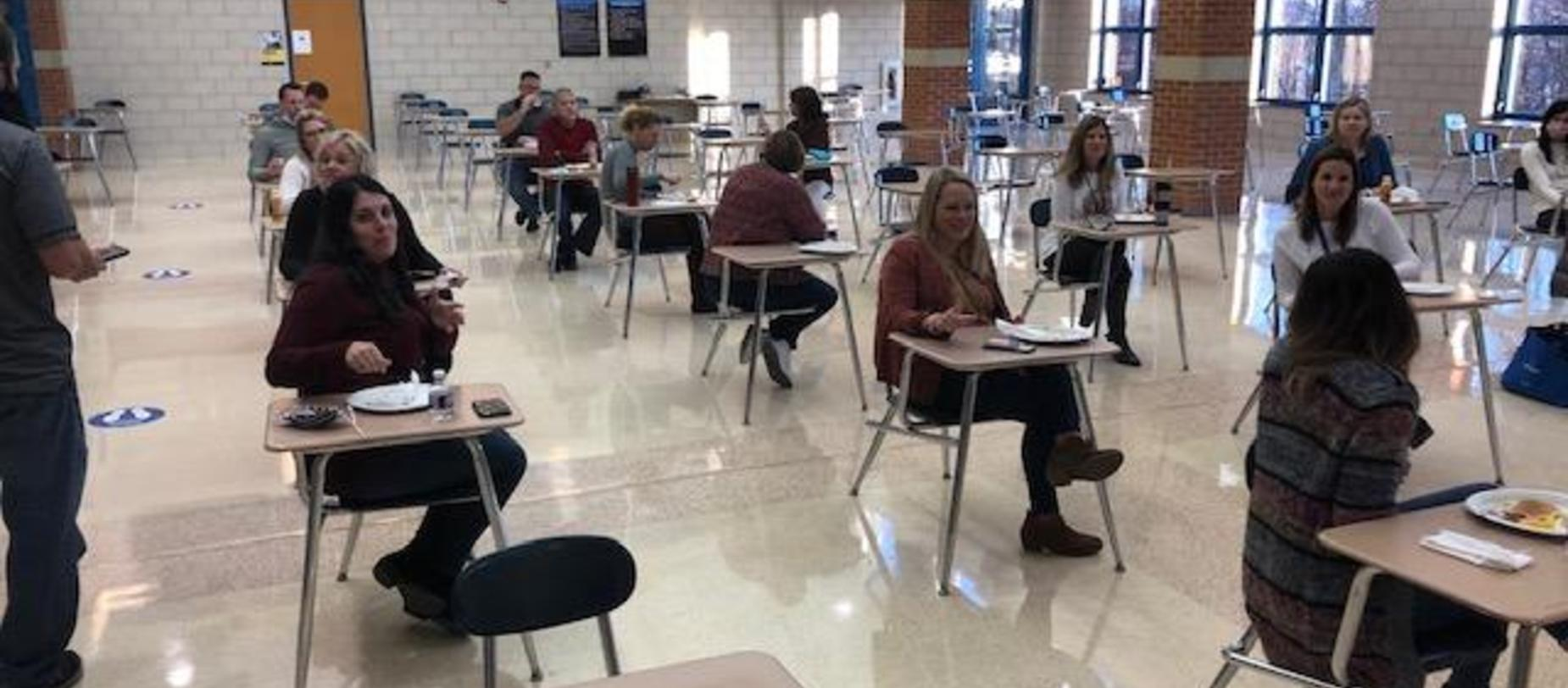 Teachers in the cafeteria for an appreciation breakfast
