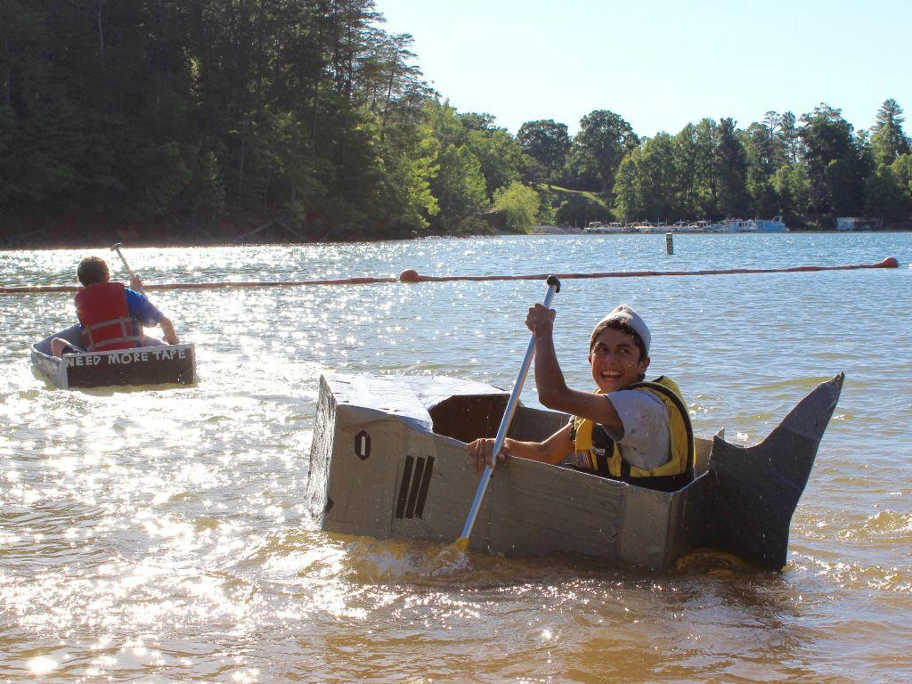 student paddling shark boat in the cardboard boat regatta