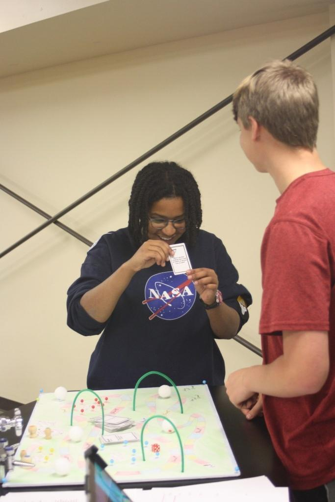 "HS Chemistry students construct board games to learn about the ""atomic structure and quantum theory"" unit."