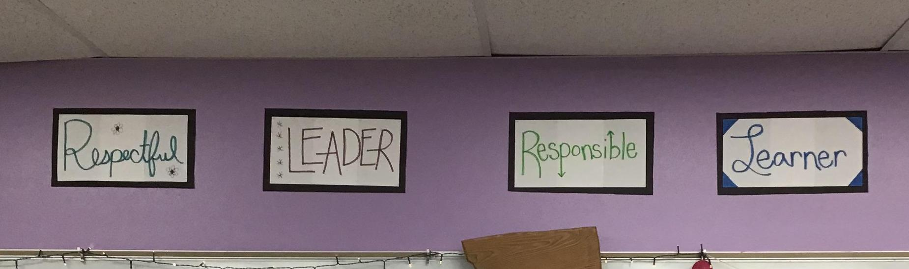 Signs on a classroom wall that read: Respectful Leader Responsible Learner