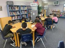 Students reading in the school library