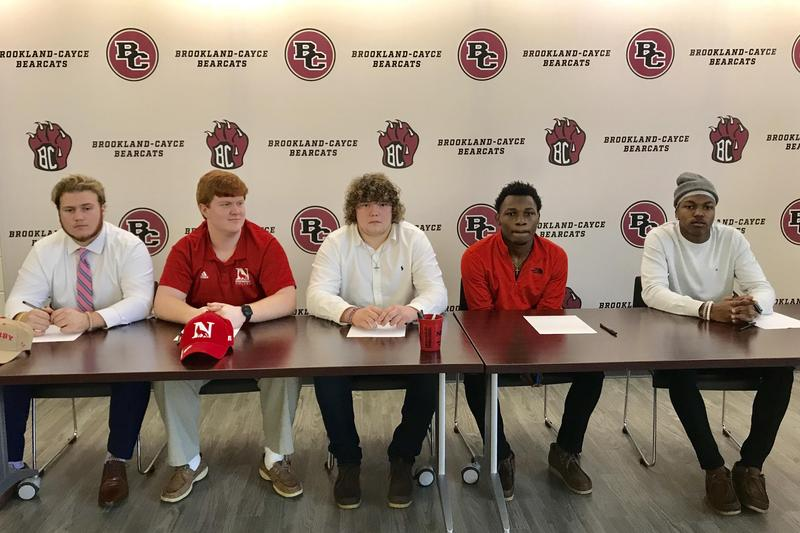 From left, Drew Weed, Tradd Castles, Brian Mims, KJ Blackmon and Malachi Brown at Wednesday's National Signing Day event at Brookland-Cayce High.
