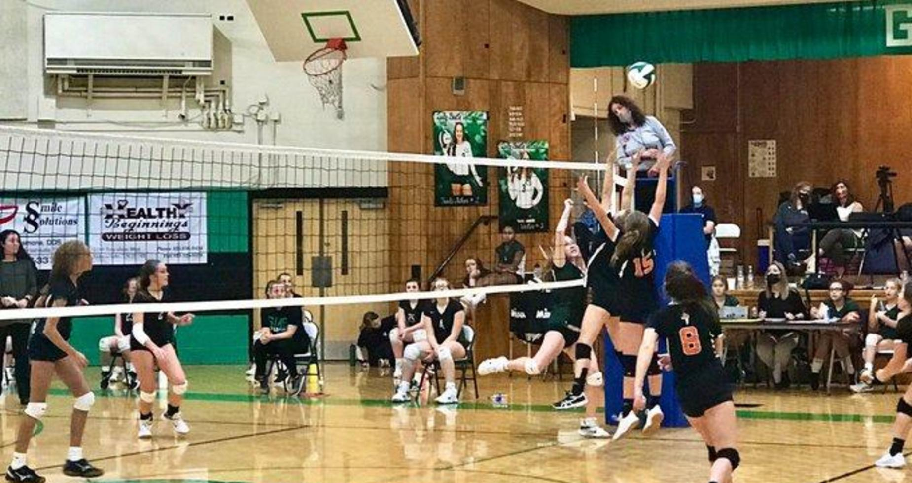 a picture of a girls volleyball game