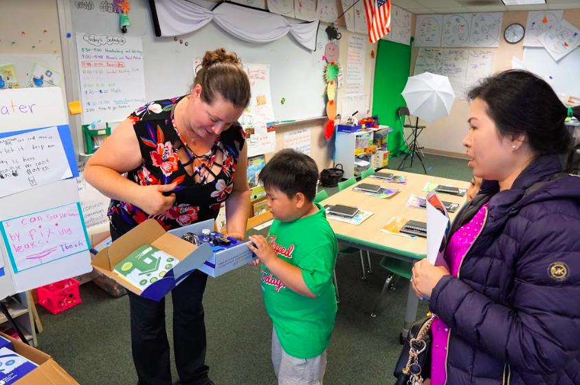 kindergarten teacher shows a kit to save water