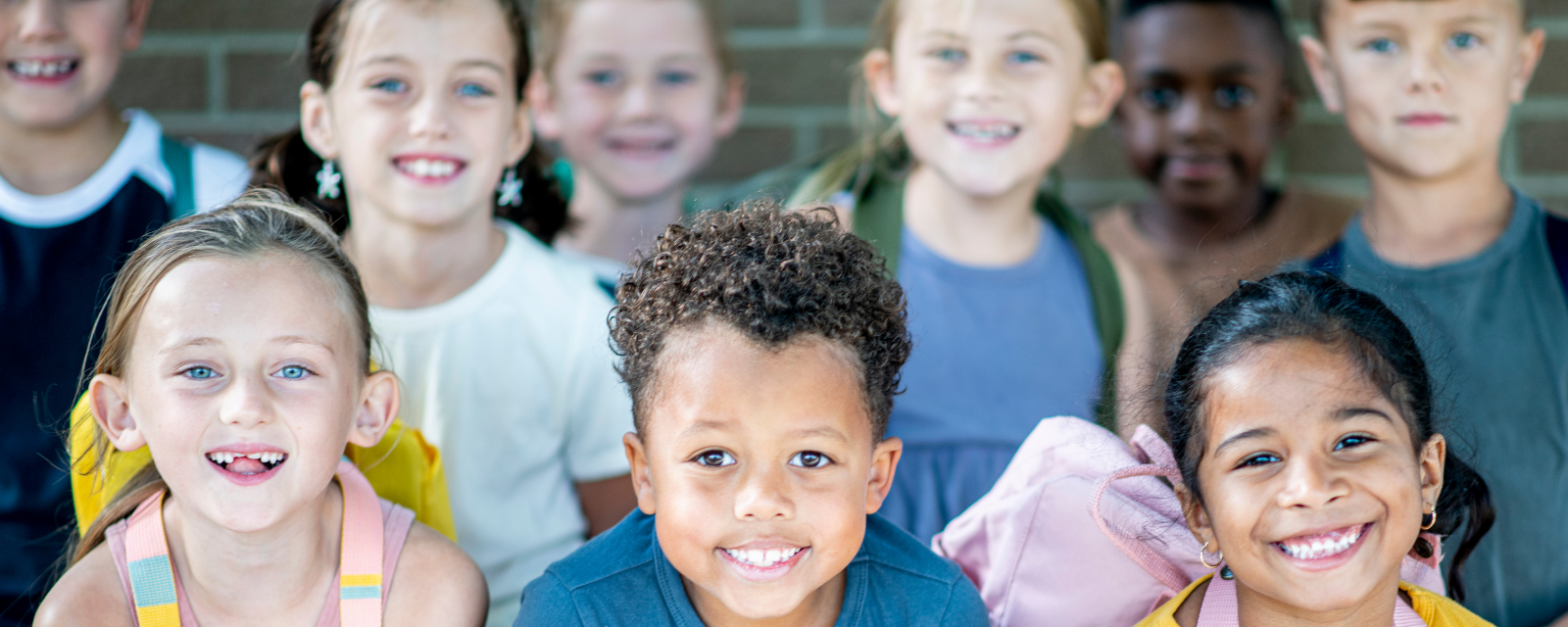 group of elementary students smiling