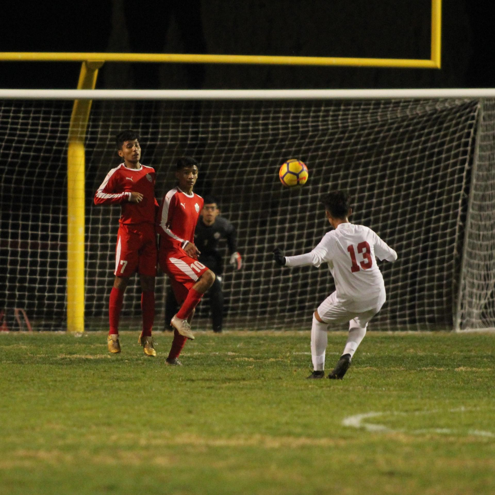 Luis Reyes and Jacob Corchado going to stop the ball
