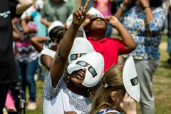 children looking at solar eclipse