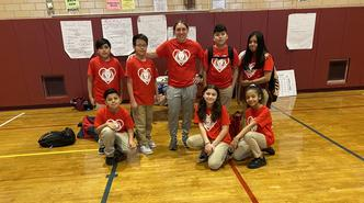 Ms. Torre and some of her students rock the red for heart disease awareness month.