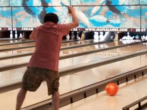 Bowler throwing ball down the lane