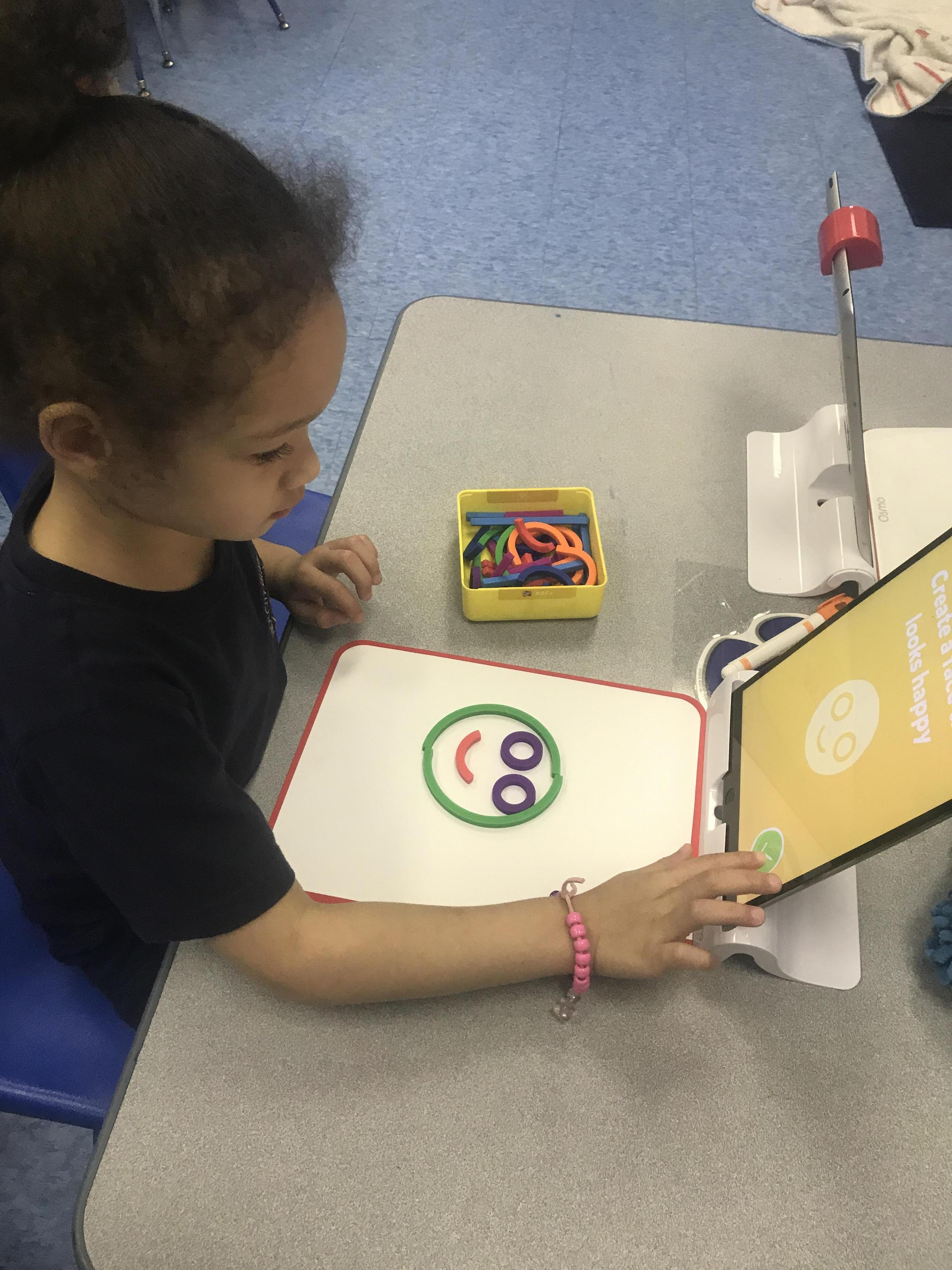 student playing on iPad