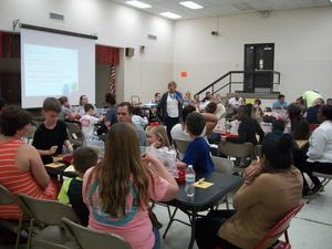 Parents and students participate in lego math activities.
