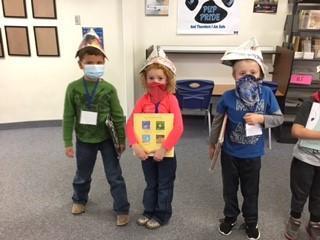 kids in newspaper hats