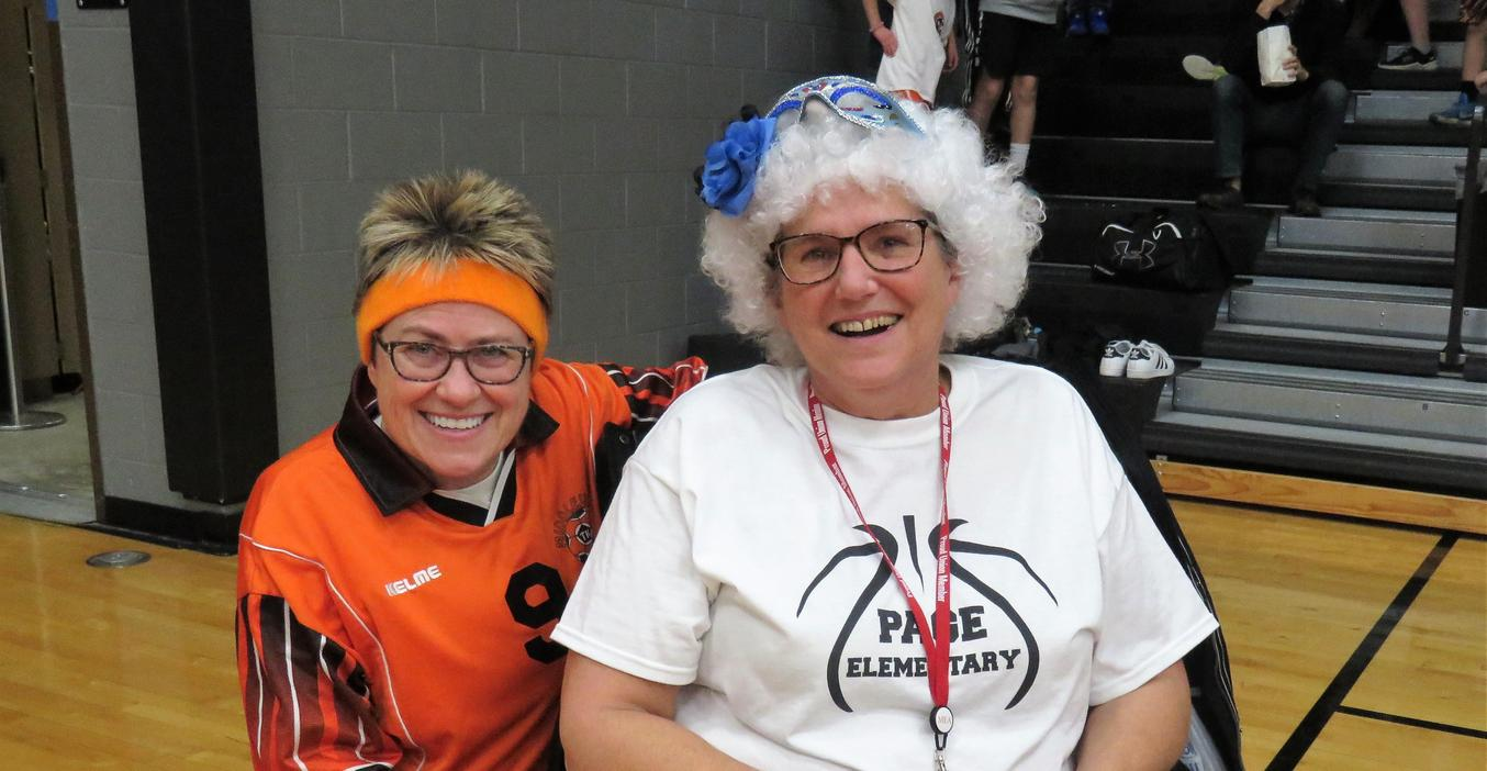 Lee Art Teacher Cathy Bailey and Page Librarian Diane Knight have fun at the annual Battle of the Buildings.