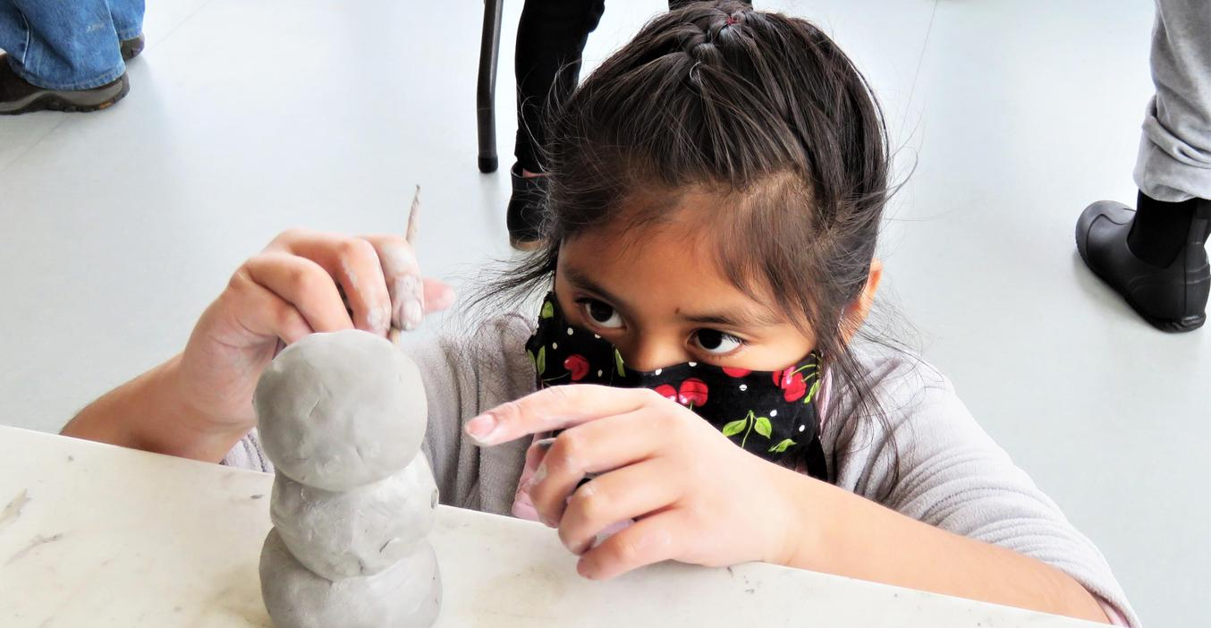 Lee students create snowmen from clay.