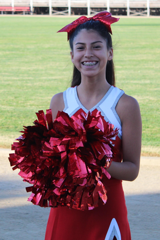 A cheerleader posing for a photograph