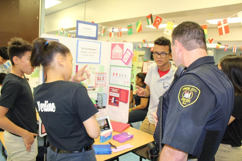 UC school officer asking students about their research board