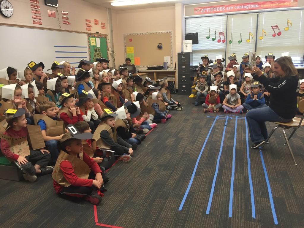 principal reading to students dressed as Pilgrims