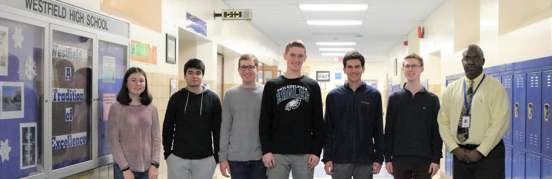 Six  Westfield High School students recently achieved the highest score possible on portions of SAT and ACT standardized tests.  The six students are pictured here with WHS principal Dr. Derrick Nelson.