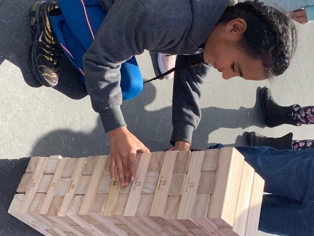student playing jumbo Jenga