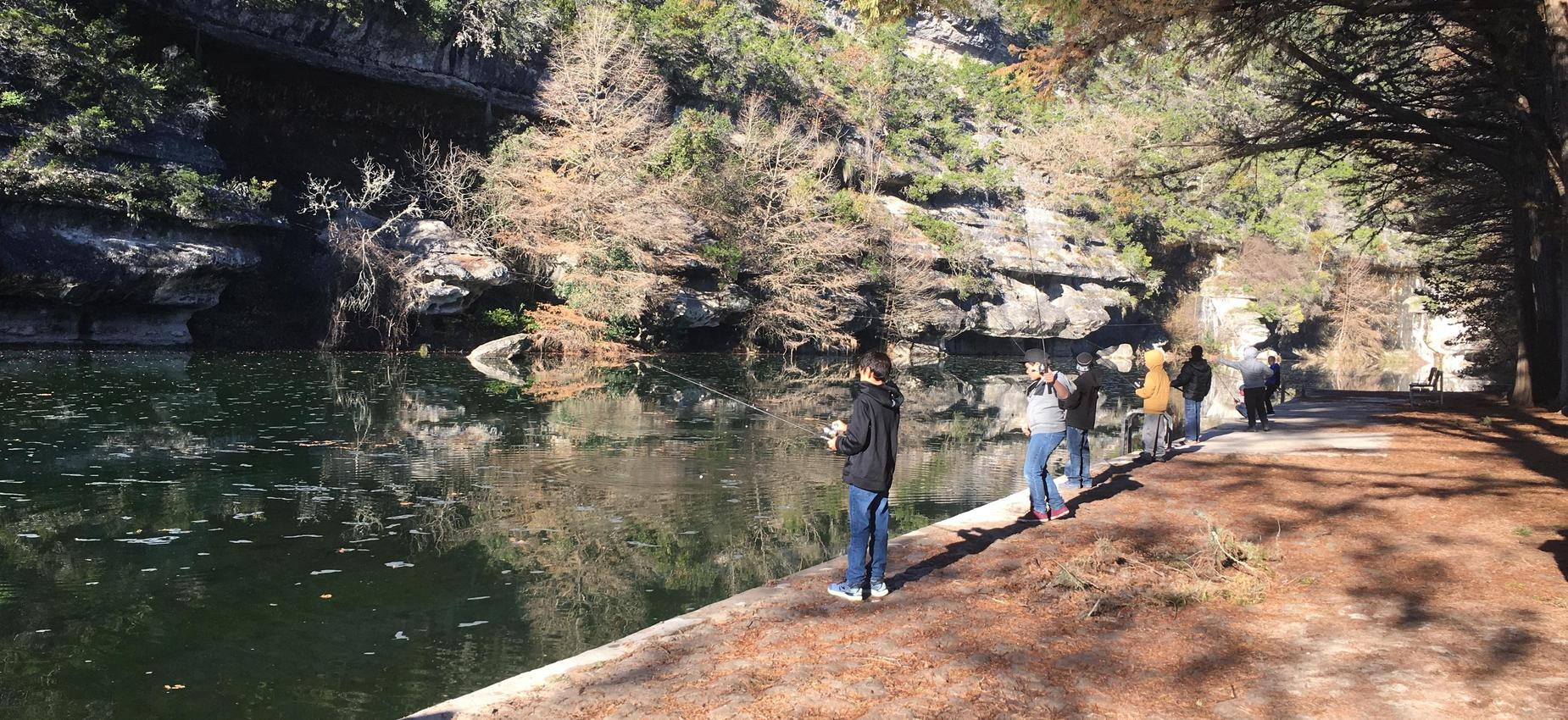 Students fishing at river