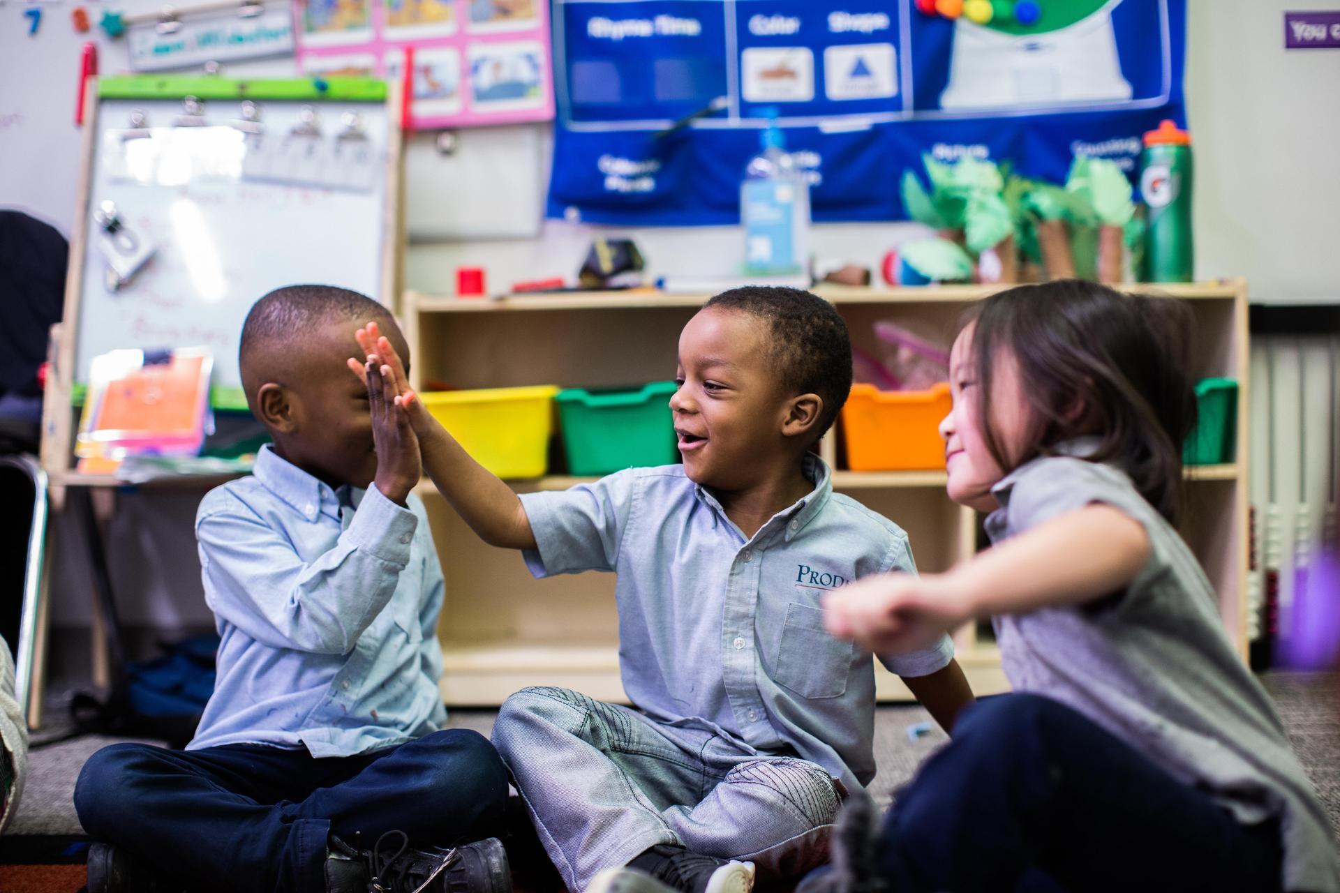 Preschoolers high-fiving
