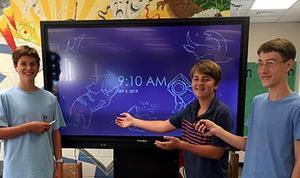 Students show off new Promethean Board.
