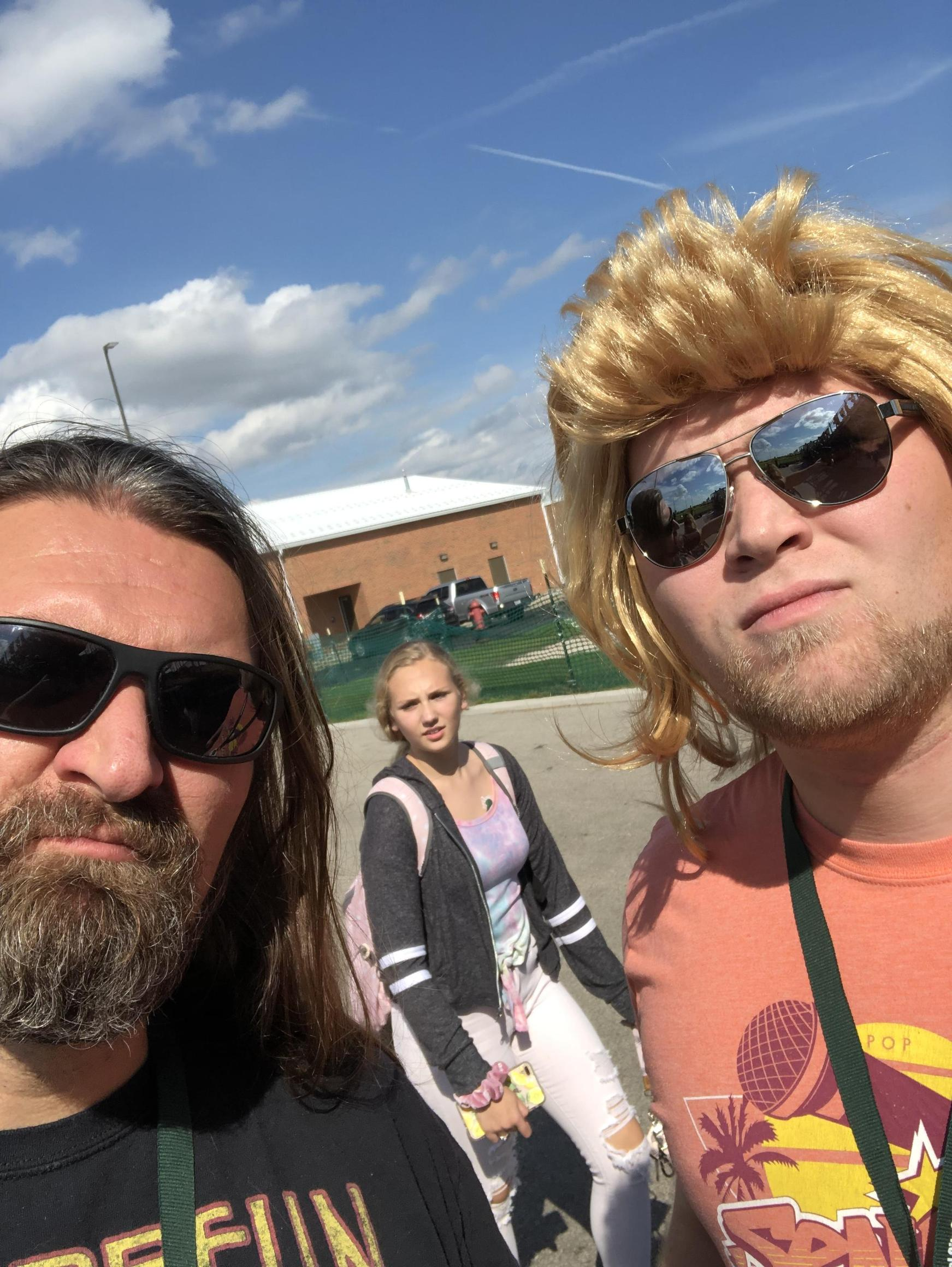 Two dudes with long hair.