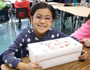 Photo of a Jefferson School student enjoying Valentine's Day activities.