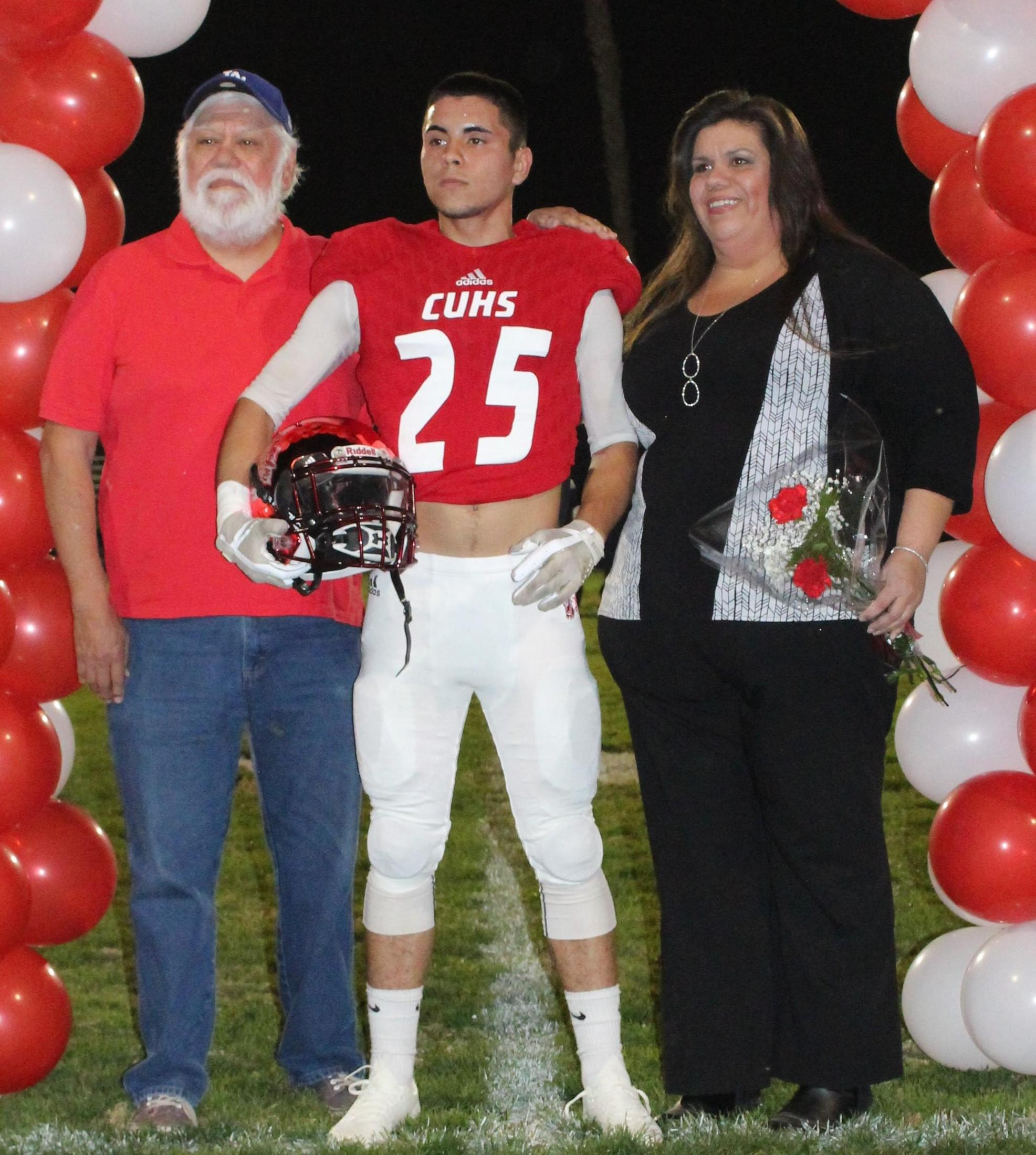 Eliseo Mendoza and his supporters at Senior Night.
