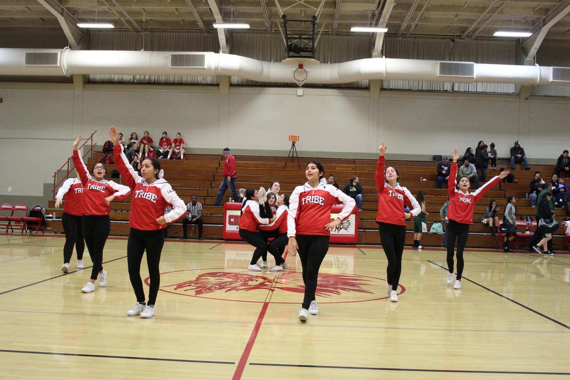 Varsity cheer at basketball against Le Grand