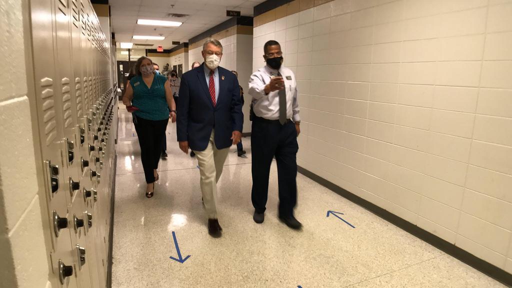 walking down hallway