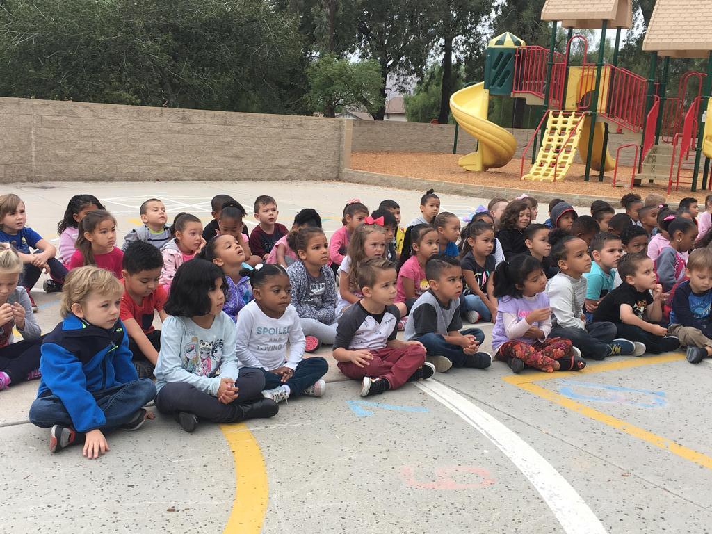 Kindergarten Students sitting on playground