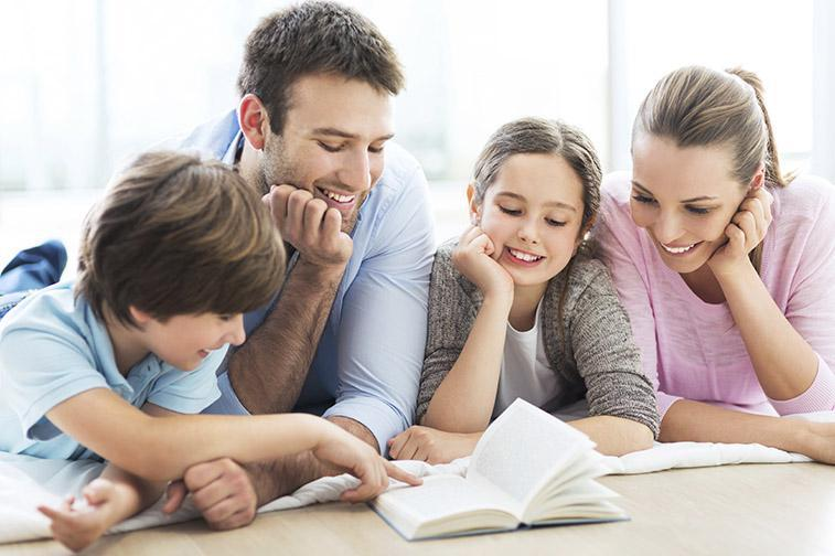 Mother and father reading with children.