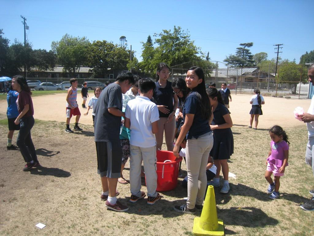 Students gather around during the PTA/ASB Community Building Picnic