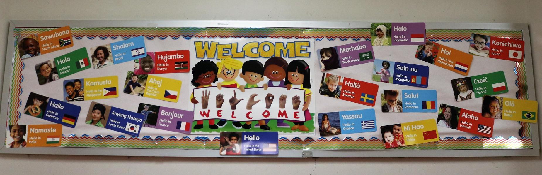 Photo of bulletin board saying Hello in different languages.
