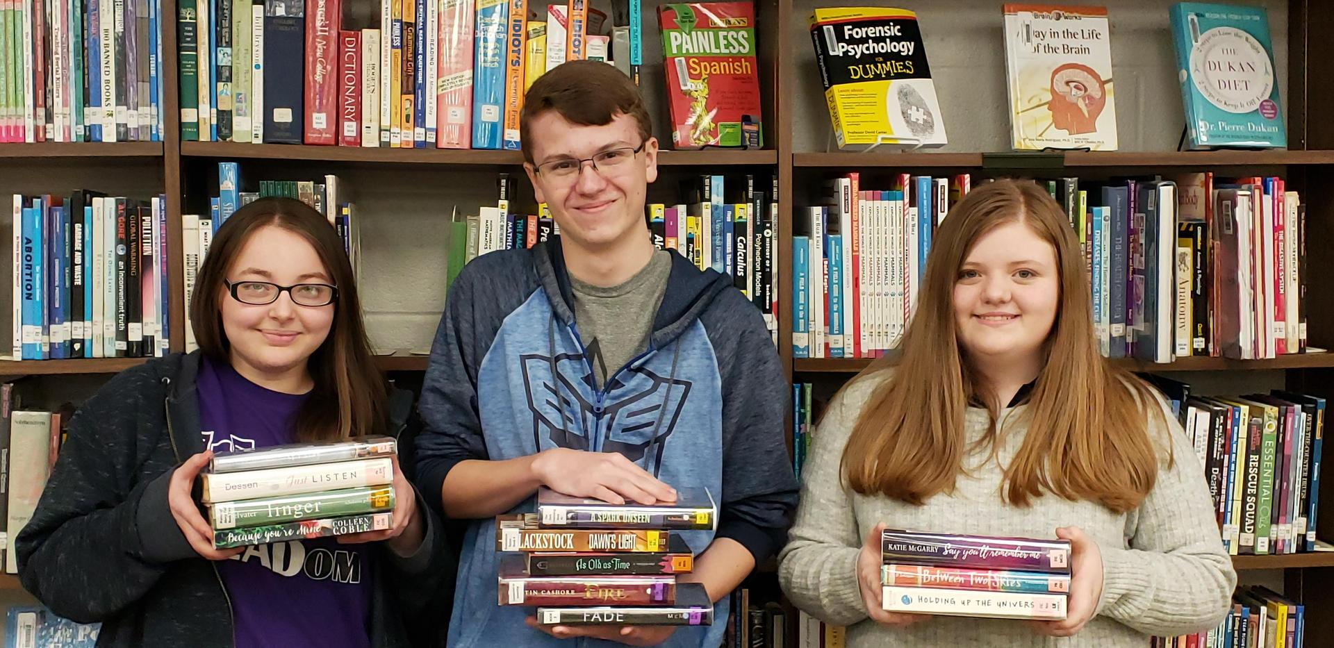 Winners of Book Spine Poetry with entries