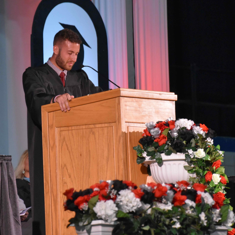 Mr. Sarratori giving a commencement speech to the Class of 2019.