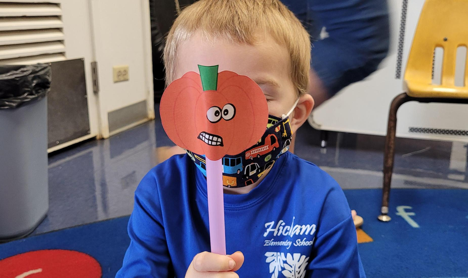 Student with pumpkin mask
