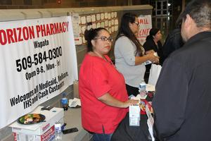 Vendor At Healthy Choices Fairs Talking to families