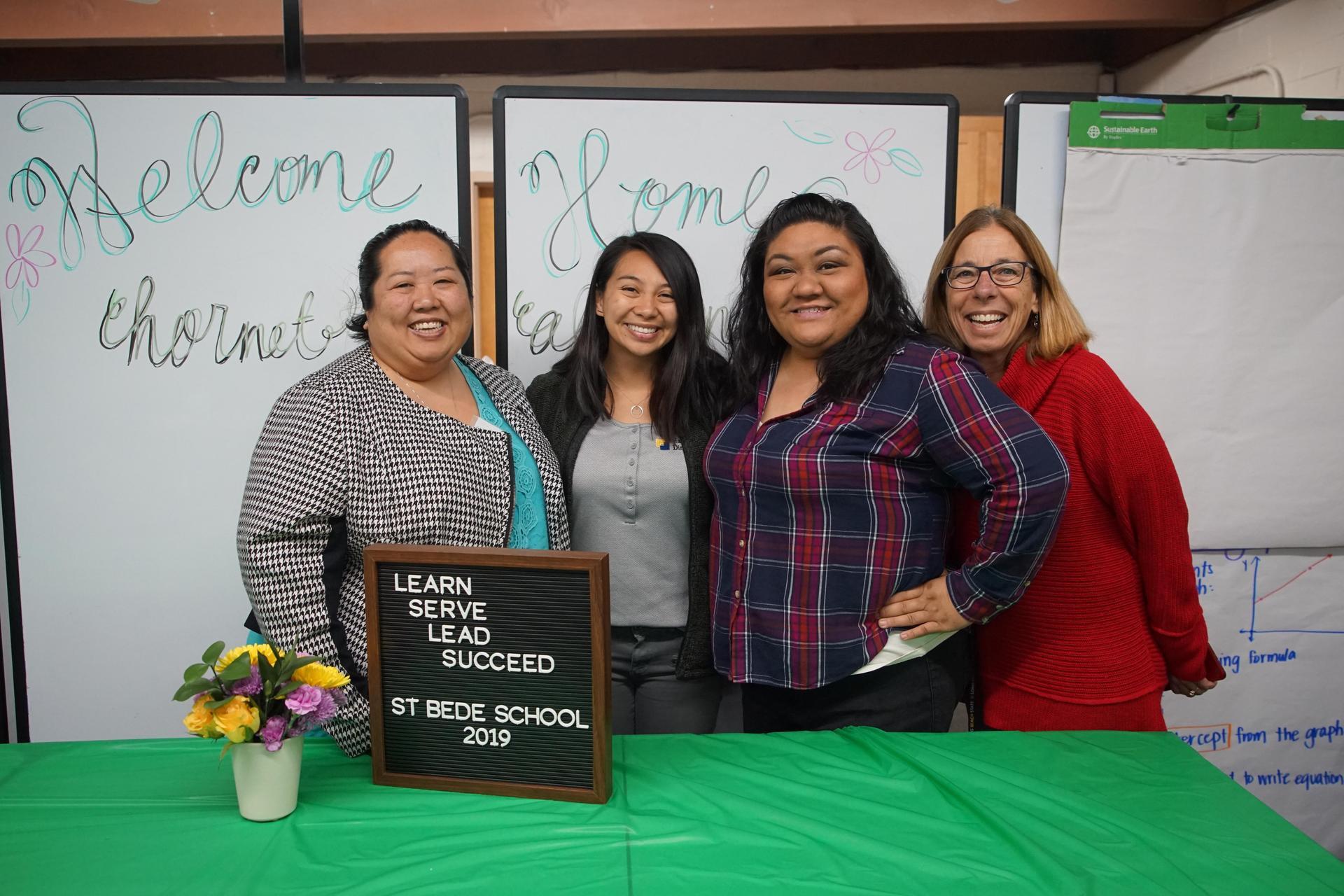 Hornet alumni with their previous art teacher, Mrs. Barton.