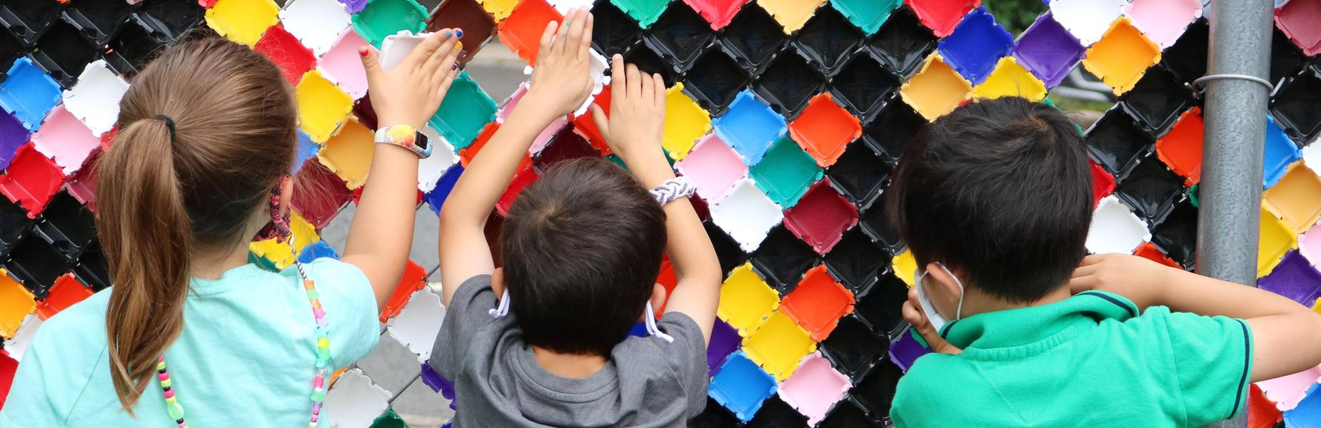Photo of Lincoln students working on playground mosaic