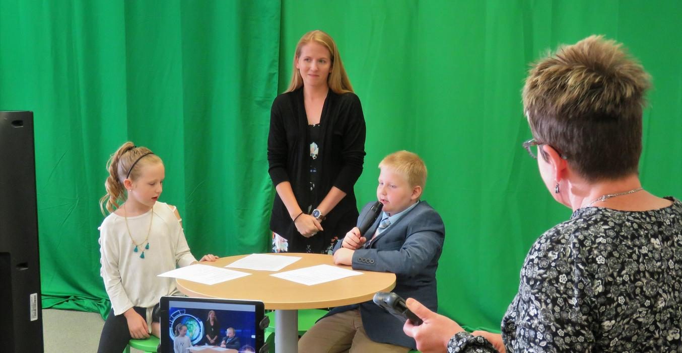 Lee Elementary students record their own morning announcements.